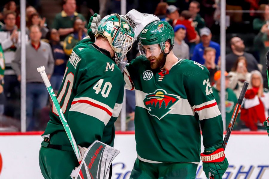 ST. PAUL, MN - APRIL 2: Goaltender Devan Dubnyk #40 and Greg Pateryn #29 of the Minnesota Wild celebrate following a 5-1 victory over the Winnipeg Jets at the Xcel Energy Center on April 2, 2019 in St. Paul, Minnesota. (Photo by Darcy Finley/NHLI via Getty Images)